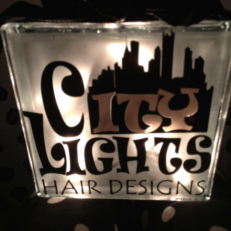 City Lights Hair Design moved to Fourth Street